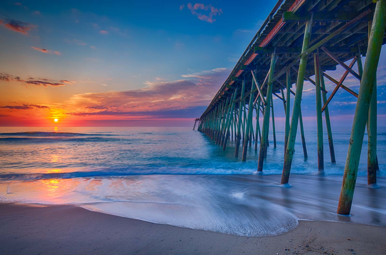 The Kure Beach Pier at Sunrise, Carolina Beach North Carolina. This Pier is a favorite place for people to fish and just simply...