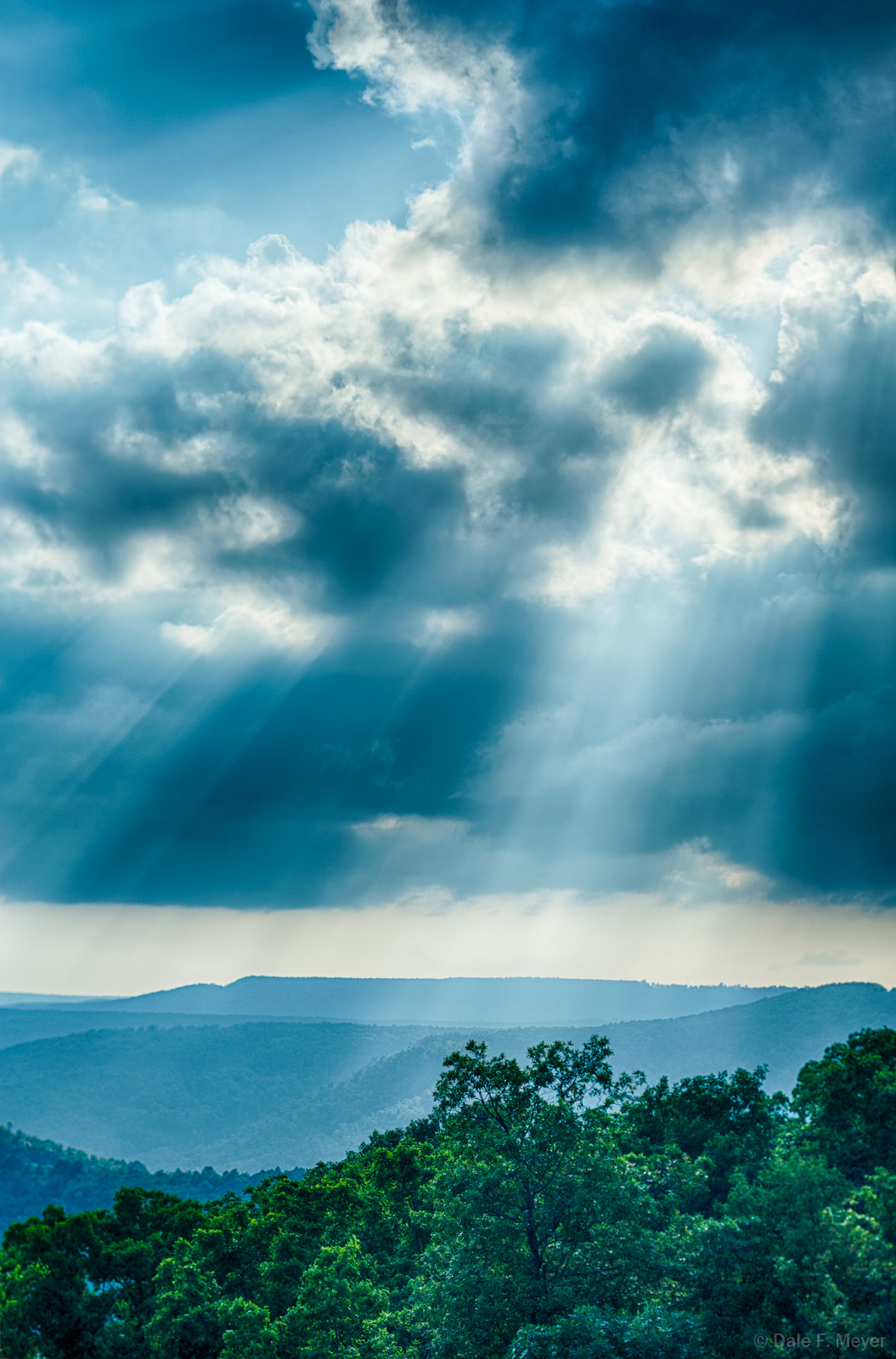 Crepuscular rays over the Boston Mountains in the Spring.