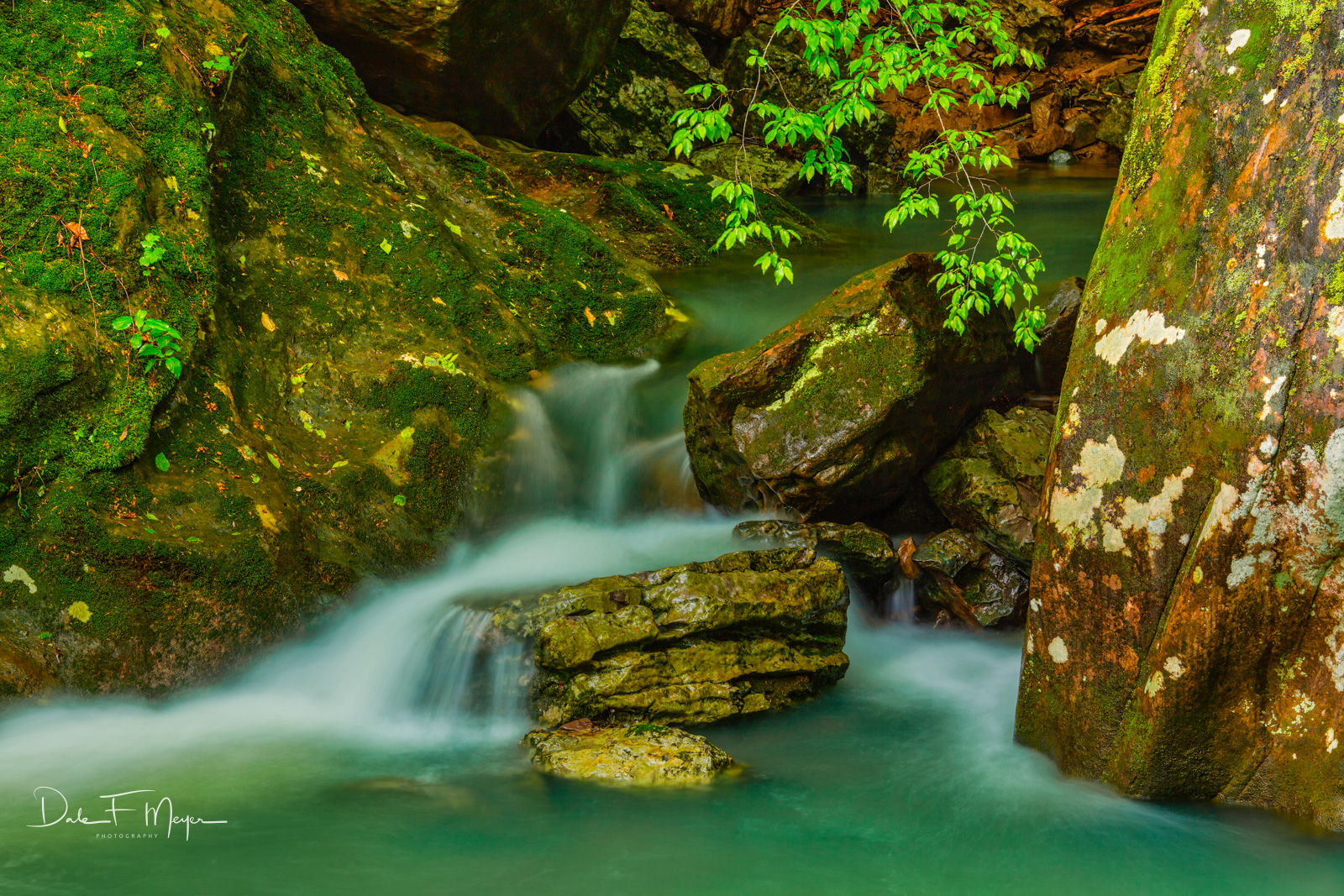 A beautiful spring flow of aqua green wateron the Smith Creek in theOzark National Forest Arkansas. This is one of...