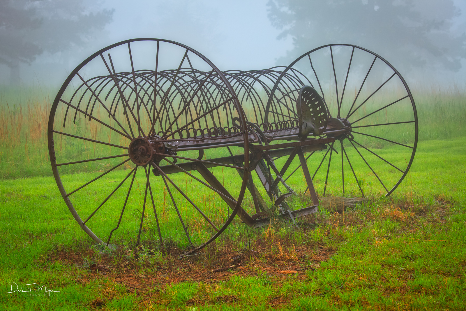 Old horse drawn hay rake,fog,spring 2011, photo