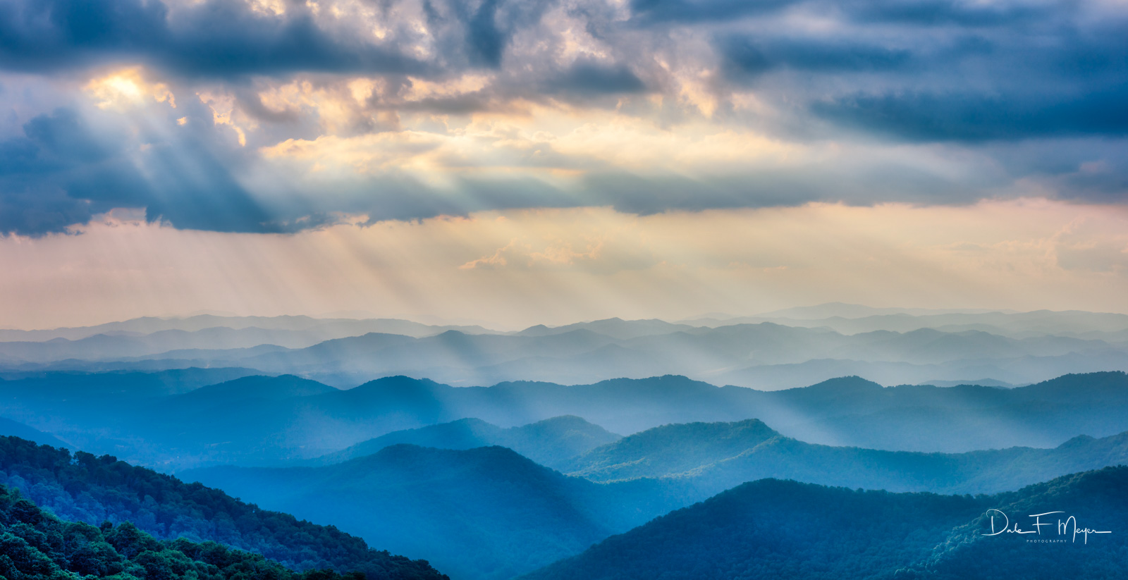 A fleeting moment of Heavens Light beaming down over the Blue Ridge Mountains south of Ashville North Carolina on the Blue Ridge...