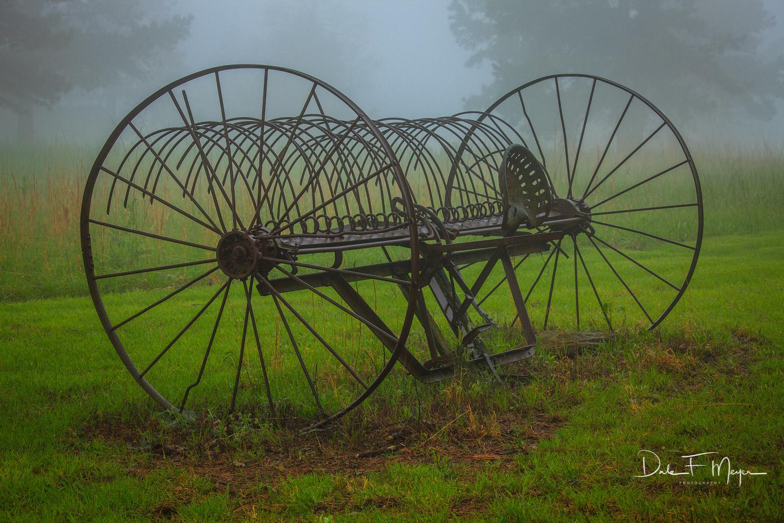 Old horse drawn hay rake,fog,spring 2011, photo