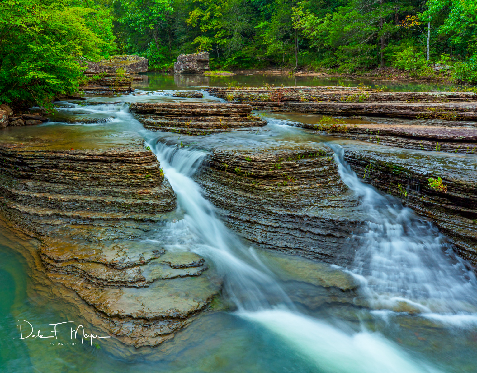 Water flowing at Six Finger Falls in the Ozark National Forrest in August. The beautiful levels of exposed stone at this place...
