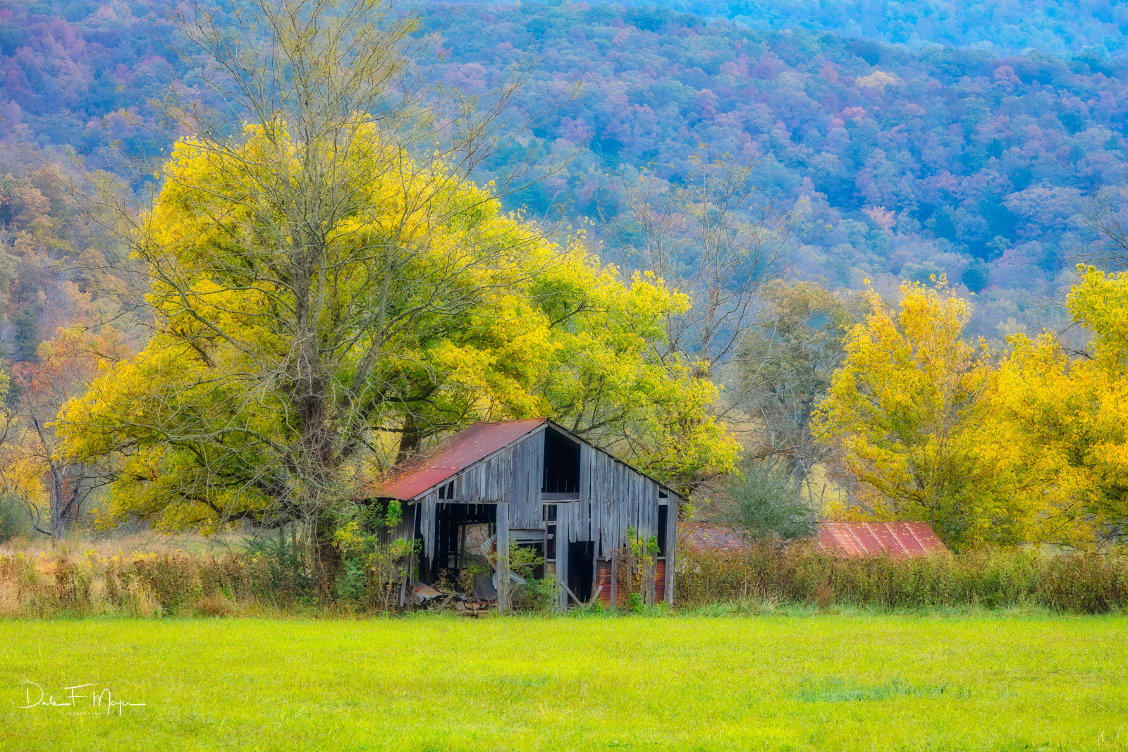 An Old Barn alone in a field with the backdrop of the Mountains in the Boxley Valley Arkansas. I caught this old barn with the...